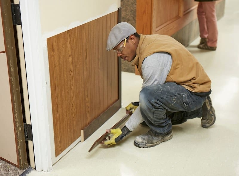 Man Installing Wall Protection