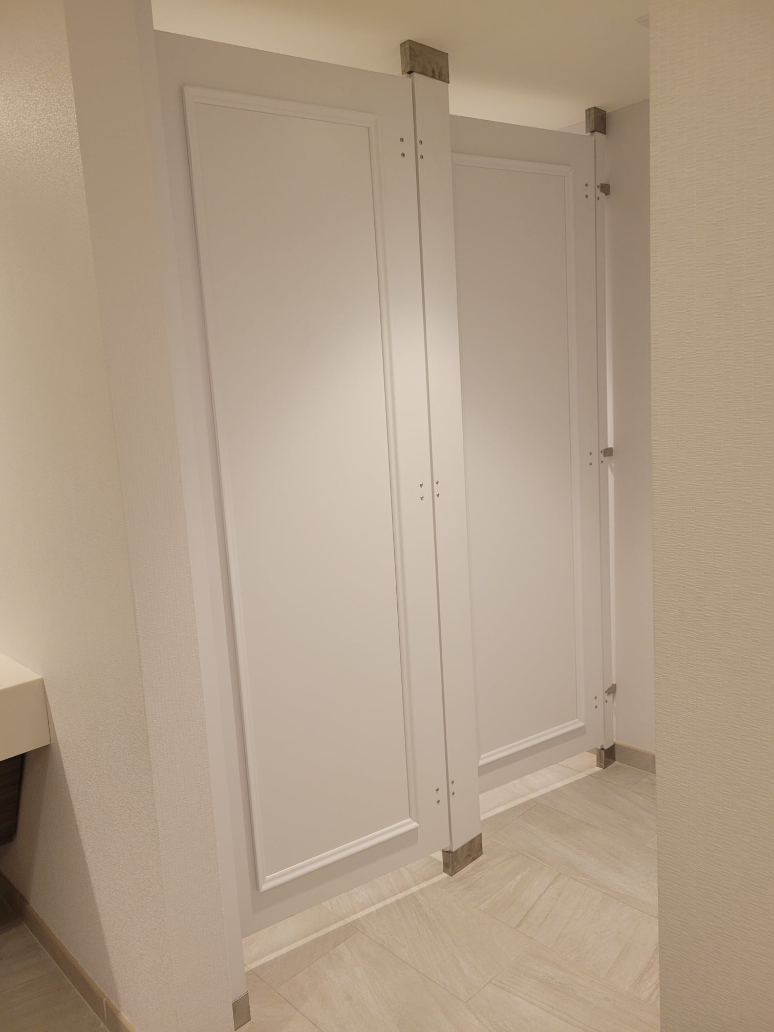 Install of White Toilet Partitions