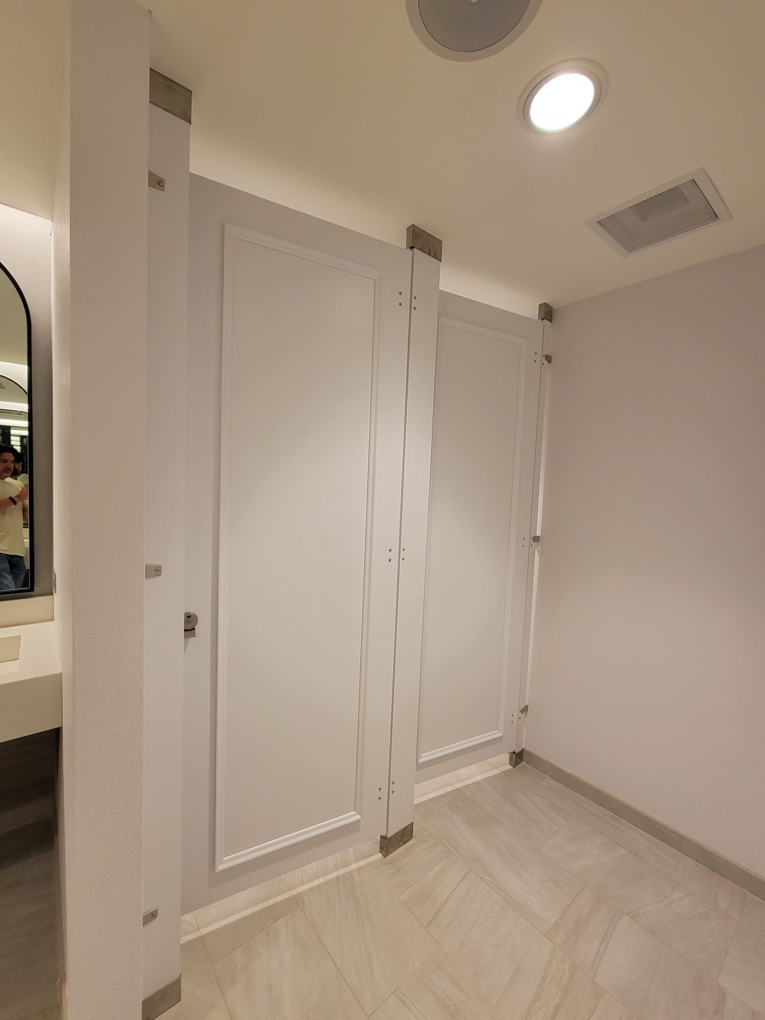 Two White Toilet Partitions